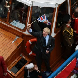 London Mayor Boris Johnson waves on a riverboat during the Royal Diamond Jubilee Pageant