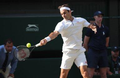 Roger Federer rerturns the ball in his match against Rafael Nadal