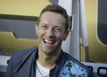 Chris Martin of Cold Play waits to perform at halftime