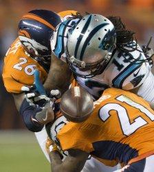 Broncos defense crush Panthers Benjamin in Denver