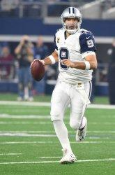 Dallas Cowboys Tony Romo scrambles against the Carollna Panthers
