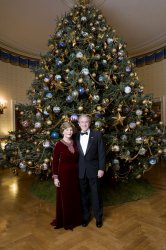 OFFICIAL PORTRAIT OF PRESIDENT WITH CHRISTMAS TREE IN WASHINGTON