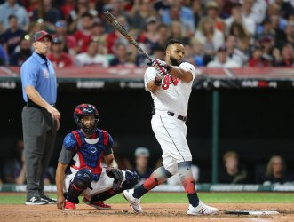 Indians' Carlos Santana hits homer during the MLB All-Star Home Run Derby in Cleveland, Ohio