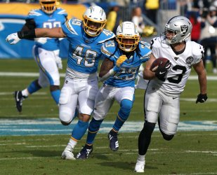 Oakland Raiders receiver Hunter Renfrow runs for a 56-yard touchdown by Los Angeles Chargers safety Rayshawn Jenkins
