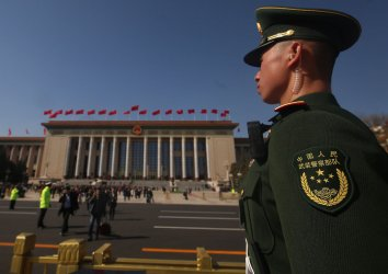 A soldier stands watch during the NPC in Beijing, China
