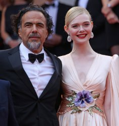 Alejandro Inarritu and Elle Fanning attend the Cannes Film Festival