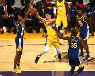Lakers Lonzo Ball has his pass deflected by Warriors Patrick McCaw