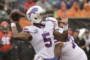 Buffalo Bills quarterback Tyrod Taylor (5) throws under pressure