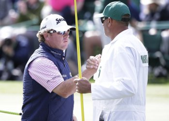 William McGirt shakes hands with Brandon Antus at the Masters