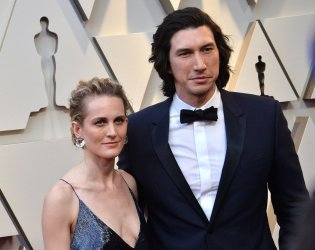 Joanne Tucker and Adam Driver arrive for the 91st Academy Awards