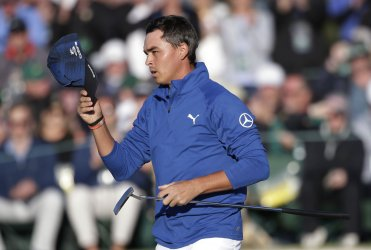 Rickie Fowler takes off his cap at the Masters