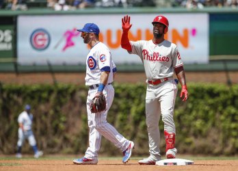 Philadelphia Phillies' Andrew McCutchen doubles at Wrigley Field in Chicago