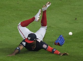 Nats Robles dives for ball in the World Series in Houston