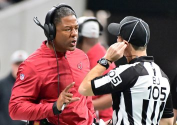 Cardinals coach Steve Wilks confers with officials during an NFL game in Atlanta