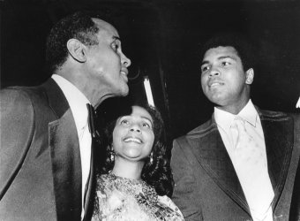 Coretta Scott King, meets with singer Harry Belafonte and boxing champion Muhammad Ali at a benefit concert