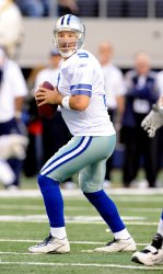 Cowboys Tony Romo looks to trow against the Chargers