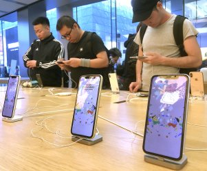 Chinese check out the latest iPhones for sale in Beijing, China
