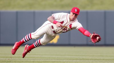 St. Louis Cardinals Kolten Wong dives for catch