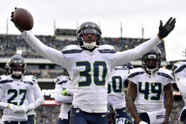 Seahawks strong safety Bradley McDougald (30) celebrates after intercepting the ball