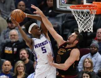 """Sacramento Kings' De""""Aaron Fox is fouled by Cleveland Cavalier defender Kevin Love"""