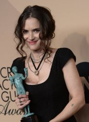 Winona Ryder wins an award at the 23rd annual SAG Awards in Los Angeles