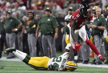 Falcons ' Julio Jones runs for 1st down over Packers'  Quinten Rollins
