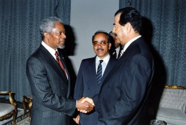 UN Secretary General Kofi Annan meets with Iraqi President Saddam Hussein