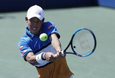 Kei Nishikori of Japan hits a backhand at the US Open