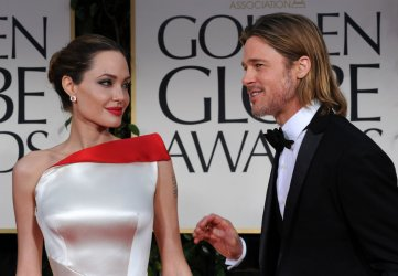 Angelina Jolie and Brad Pitt arrive at the 69th annual Golden Globe Awards in Beverly Hills, California