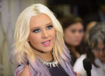 Christina Aguilera is interviewed following the announcement of the 2012 American Music Awards nominees in Los Angeles