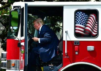 President Trump Sits in Firetruck Made in America