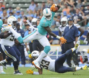 Miami Dolphins' DeVante Parker is stopped by the Chargers in Carson, California