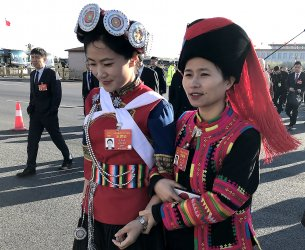 Chinese delegates arrive for the NPC in Beijing, China