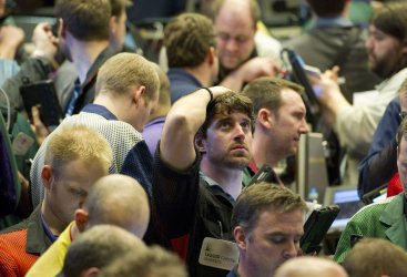 Trader watches board in S&P 500 options pit at CBOE in Chicago