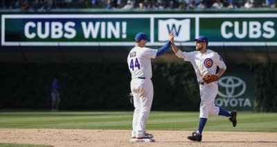 Cubs Anthony Rizzo celebrates with Ben Zobrist their win against the Blue Jays in Chicago
