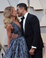 Kelly Ripa and Mark Consuelos arrive for the 91st Academy Awards