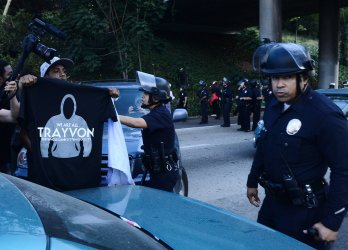 Demonstrators march in Los Angeles protesting George Zimmerman acquital