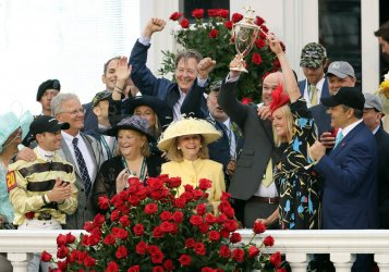 Owners of Country House celebrate after he won the 145th Kentucky Derby