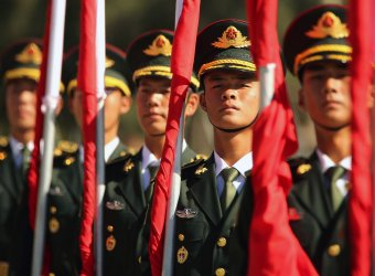 Chinese soldiers prepare to perform honor guard duties in Beijing