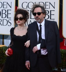 Actress Helena Bonham Carter and director Tim Burton attend the 70th annual Golden Globe Awards in Beverly Hills, California