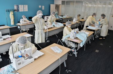All Nippon Airways staffs make medical gowns in Tokyo