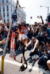 Anti-Ku Klux Klan demonstrators burn an American flag.