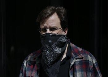 Pedestrians wear face masks in New York