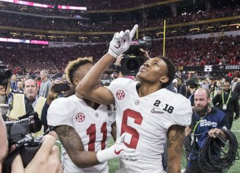 Alabama's DeVonta Smith celebrates catching the winning touchdown against the Georgia Bulldogs in the National Championship