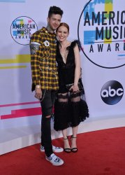 Travis Mills and Madelaine Petsch attend the annual 2017 American Music Awards in Los Angeles