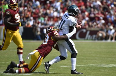 Eagles QB Carson Wentz brought down by Redskins' Zach Brown