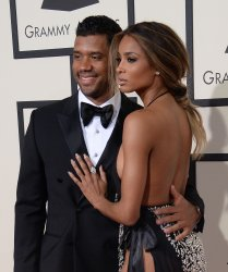 Russell Wilson and Ciara arrive for the 58th annual Grammy Awards in Los Angeles