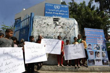Palestinian children protests against the killing of children at UNRWA School