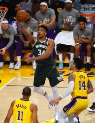 Milwaukee Bucks forward Giannis Antetokounmpo (L)  scores on a layup past Los Angeles Lakers Danny Green at Staples Center