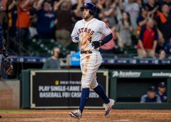 Astros' George Springer scores a run